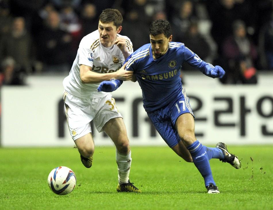 Ben Davies (L) and Eden Hazard