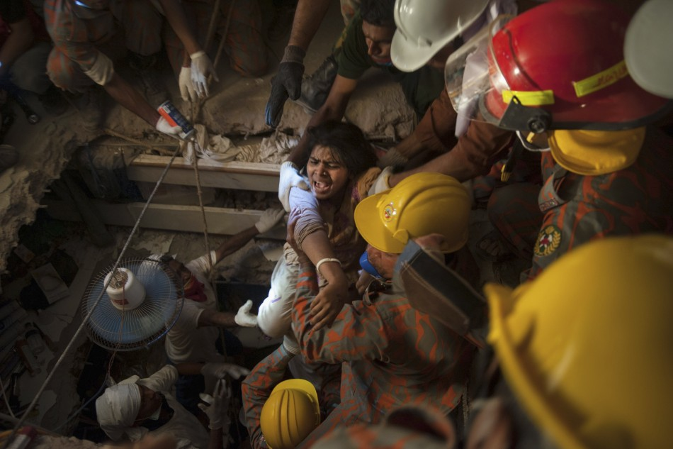 Rescuers pull a survivor from the rubble of the Rana complex