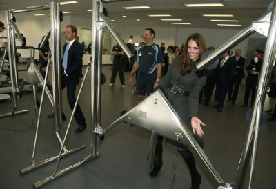 Prince William and his wife Catherine, Duchess of Cambridge play a reaction game in the new gym during the official launch of The Football Associations National Football Centre at St Georges Park in Burton upon Trent, central England October 9