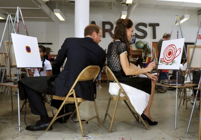 Catherine, Duchess of Cambridge smiles as her husband Britains Prince William comments on her artistic skills during a visit to the Inner City Arts campus in Los Angeles July 10, 2011.