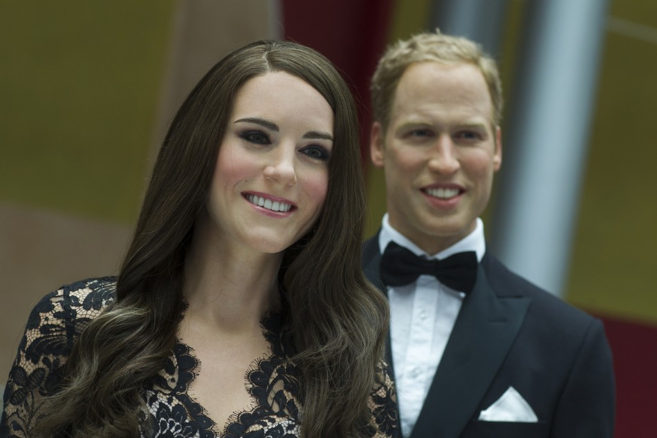 Wax figures of Kate Middleton, Duchess of Cambridge, and Prince William are on display during a media reception at the British embassy in Berlin, August 16, 2012.