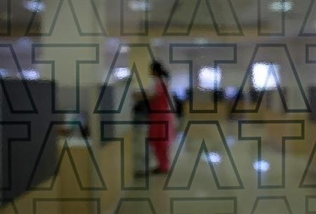 An employee of Tata Consultancy Services (TCS) works inside the company headquarters in Mumbai March 14, 2013.