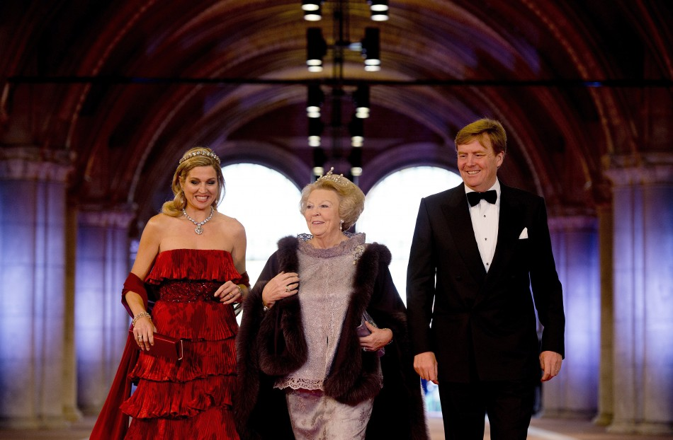 Dutch Crown Prince Willem-Alexander R, his wife Crown Princess Maxima and Queen Beatrix C of the Netherlands arrive at a gala dinner organised on the eve of the abdication of the Queen and the inauguration of her successor King Willem-Alexander at the