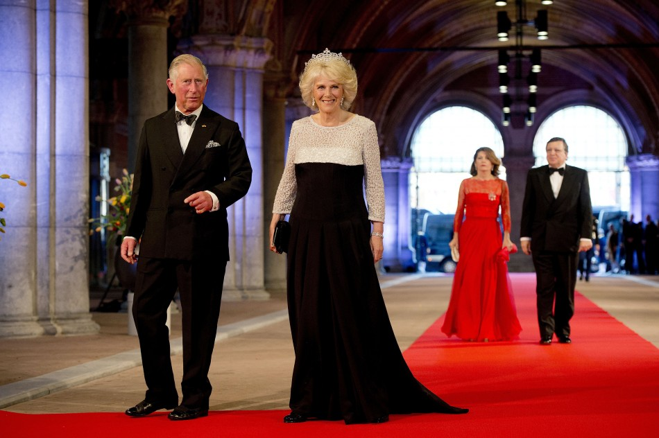 Prince Charles L and his wife Camilla, Duchess of Cornwall, arrive at a gala dinner organised on the eve of the abdication of Queen Beatrix of the Netherlands and the inauguration of her successor King Willem-Alexander at the Rijksmuseum in Amsterdam Ap