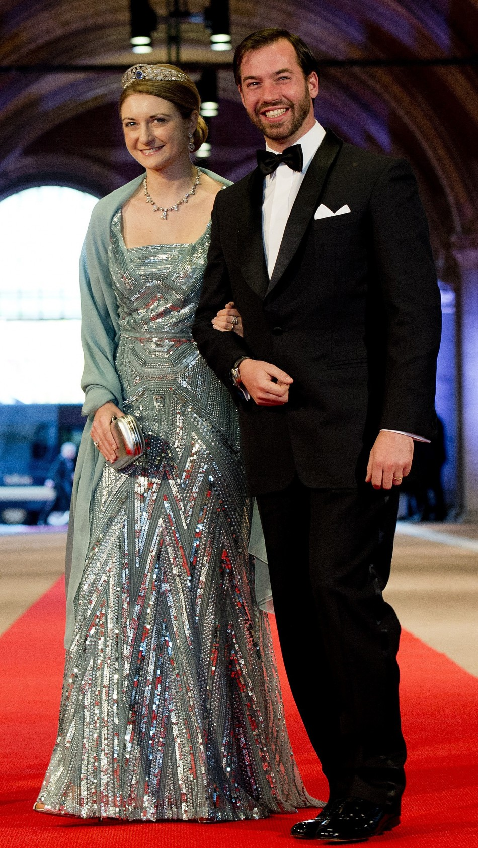 Luxembourgs Hereditary Grand Duke Guillaume R and his wife Princess Stephanie arrive at a gala dinner organised on the eve of the abdication of Queen Beatrix of the Netherlands and the inauguration of her successor King Willem-Alexander at the Rij