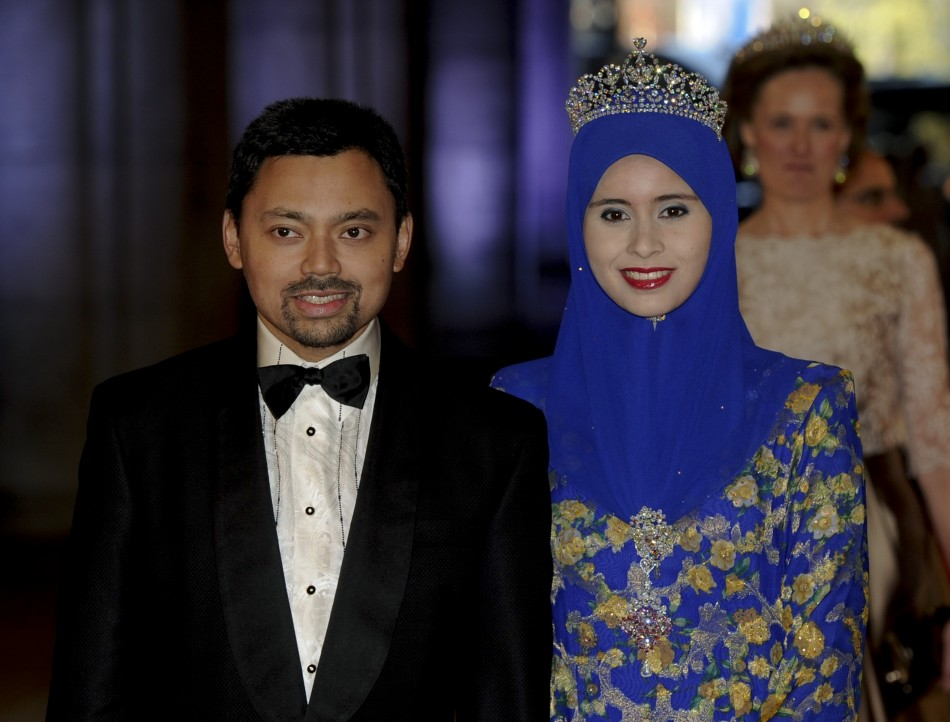 Bruneis Crown Prince Haji Al-Muhtadee Billah L and his wife Pengiran Anak Sarah arrive at a gala dinner organised on the eve of the abdication of Queen Beatrix of the Netherlands and the inauguration of her successor King Willem-Alexander at the R