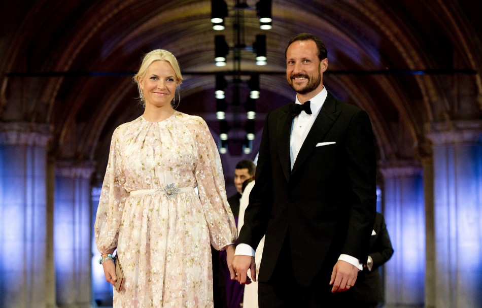 Norways Crown Princess Mette-Marit and Crown Prince Haakon R arrive at a gala dinner organised on the eve of the abdication of Queen Beatrix of the Netherlands and the inauguration of her successor King Willem-Alexander at the Rijksmuseum in Amste
