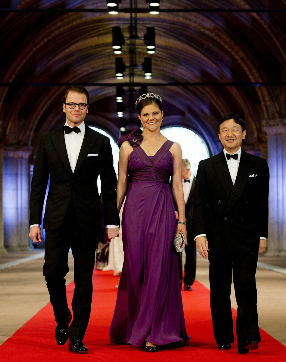 Crown Princess Victoria C of Sweden, her husband Prince Daniel L and Crown Prince Naruhito of Japan arrive at a gala dinner organised on the eve of the abdication of Queen Beatrix of the Netherlands and the inauguration of her successor King Willem-Al
