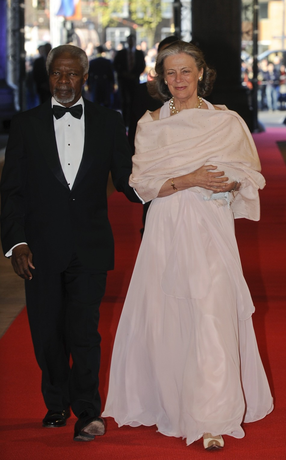 Former U.N. Secretary-General Kofi Annan and his wife Nane R arrive at a gala dinner organised on the eve of the abdication of Queen Beatrix of the Netherlands and the inauguration of her successor King Willem-Alexander at the Rijksmuseum in Amsterdam A