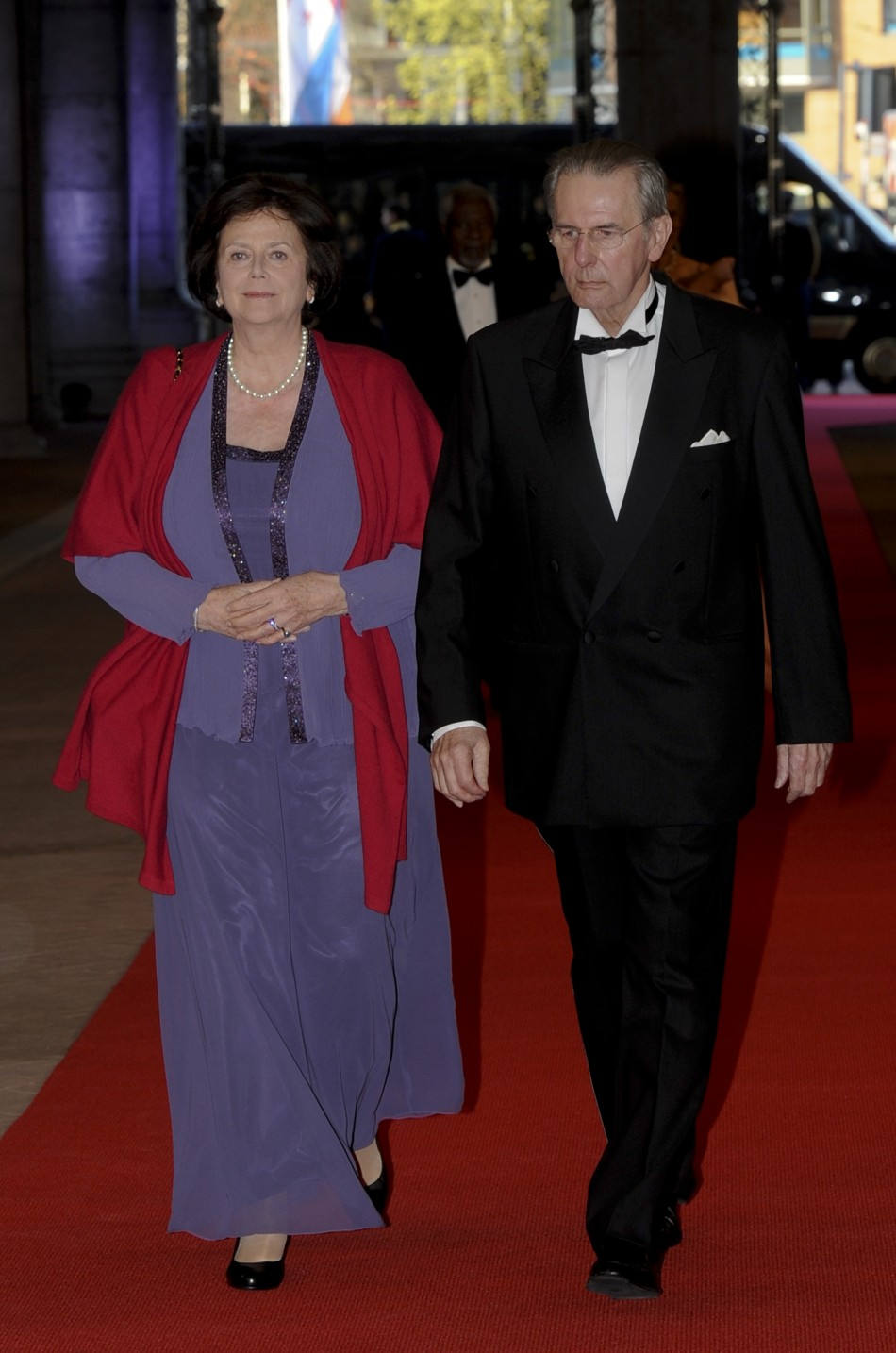 International Olympic Committee IOC President Jacques Rogge R and his wife Anne Rogge arrive at a gala dinner organised on the eve of the abdication of Queen Beatrix of the Netherlands and the inauguration of her successor King Willem-Alexander at the