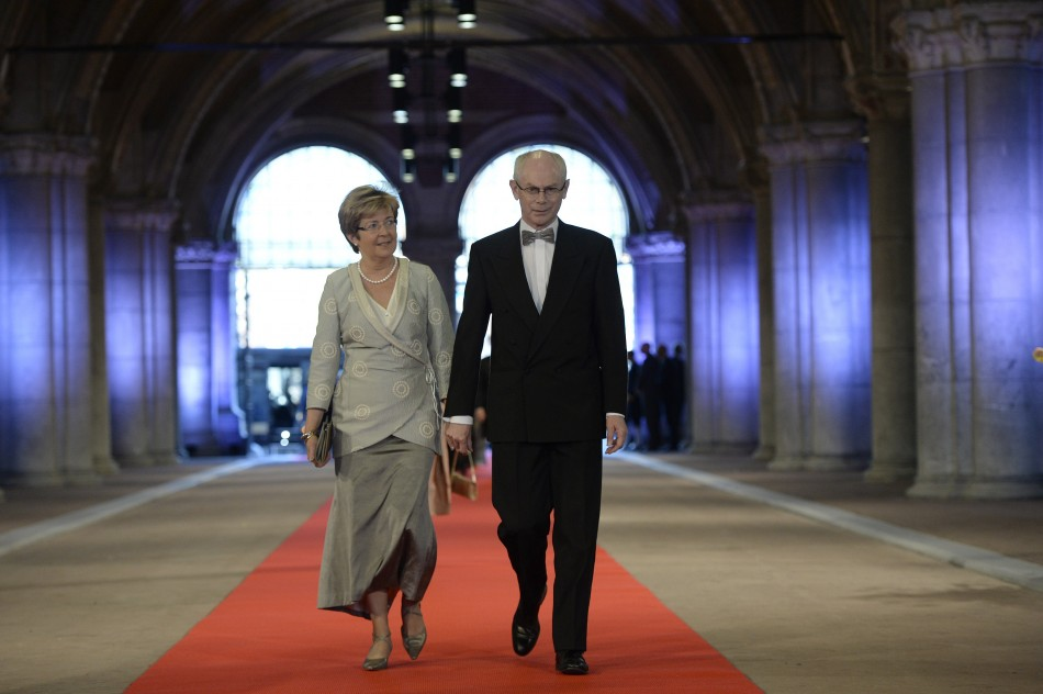 European Council President Herman Van Rompuy R and his wife Geertrui Windels arrive at a gala dinner organised on the eve of the abdication of Queen Beatrix of the Netherlands and the inauguration of her successor King Willem-Alexander at the Rijksmuseu