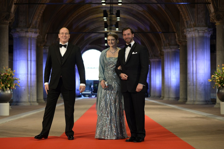 Prince Albert II L of Monaco arrives with Luxembourgs Hereditary Grand Duke Guillaume R and his wife Princess Stephanie at a gala dinner organised on the eve of the abdication of Queen Beatrix of the Netherlands and the inauguration of her succe