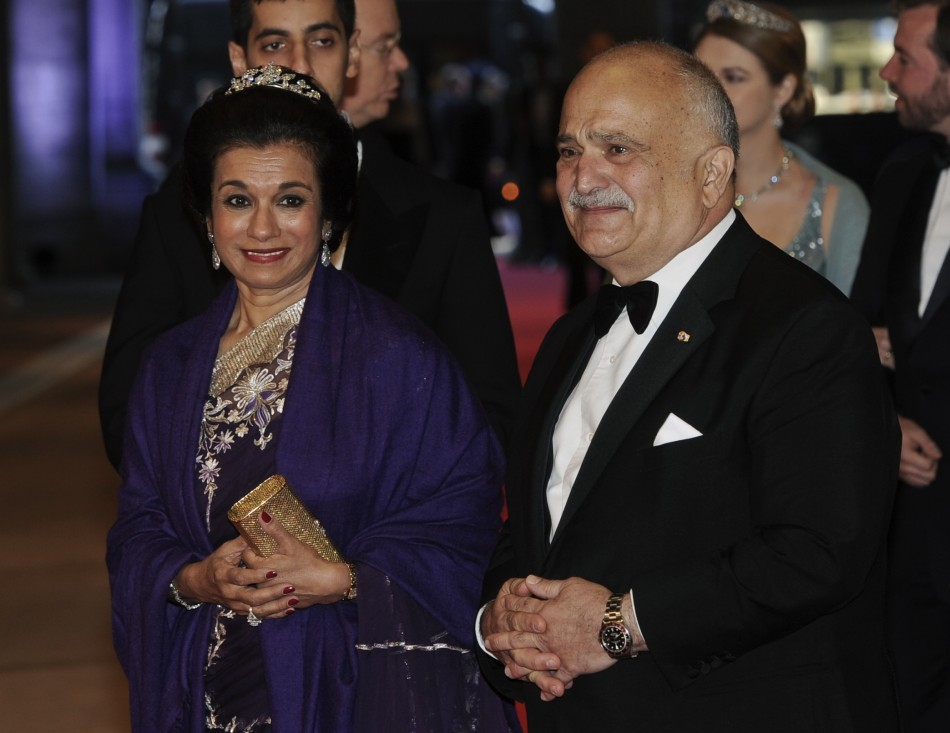 Jordans Prince Hassan Bin Talal R and his wife Princess Sarvath El Hassan bin Talal arrive at a gala dinner organised on the eve of the abdication of Queen Beatrix of the Netherlands and the inauguration of her successor King Willem-Alexander at t