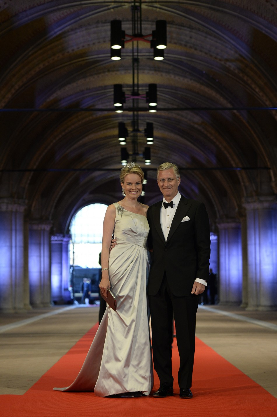 Belgian Crown Prince Philippe R and his wife Crown Princess Mathilde arrive at a gala dinner organised on the eve of the abdication of Queen Beatrix of the Netherlands and the inauguration of her successor King Willem-Alexander at the Rijksmuseum in Ams
