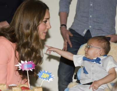 Catherine, Duchess of Cambridge, speaks with a child during her visit to the Naomi House childrens hospice in Sutton Scotney, southern England