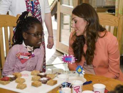 Catherine, Duchess of Cambridge, speaks with a child during her visit to the Naomi House childrens hospice in Sutton Scotney, southern England April 29, 2013.