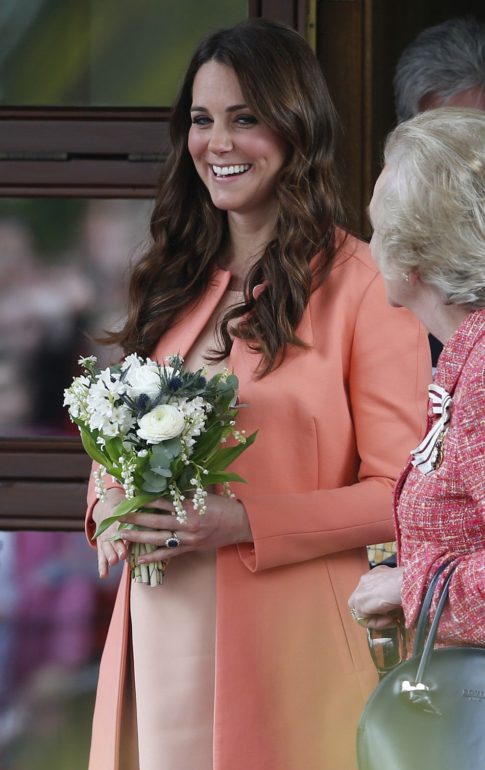 Catherine, Duchess of Cambridge, smiles as she leaves after visiting the Naomi House childrens hospice in Sutton Scotney, southern England
