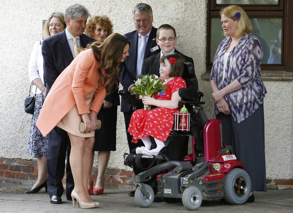 Catherine, Duchess of Cambridge, speaks with Sally Evans, aged 8
