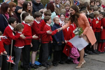 Catherine, Duchess of Cambridge, greets school children as she leaves after visiting the Naomi House childrens hospice in Sutton Scotney, southern England