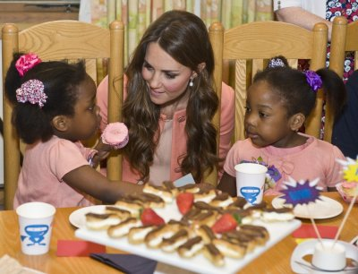 Catherine, Duchess of Cambridge, speaks with children during her visit to the Naomi House childrens hospice