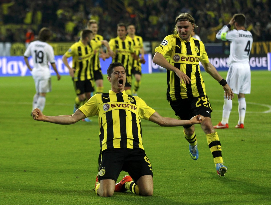 Borussia Dortmund's Lewandowski celebrates scoring hat-trick against Real Madrid in Champions League semi-final first leg soccer match in Dortmund.