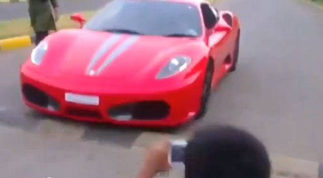 Nine-year-old drives Ferrari, father arrested
