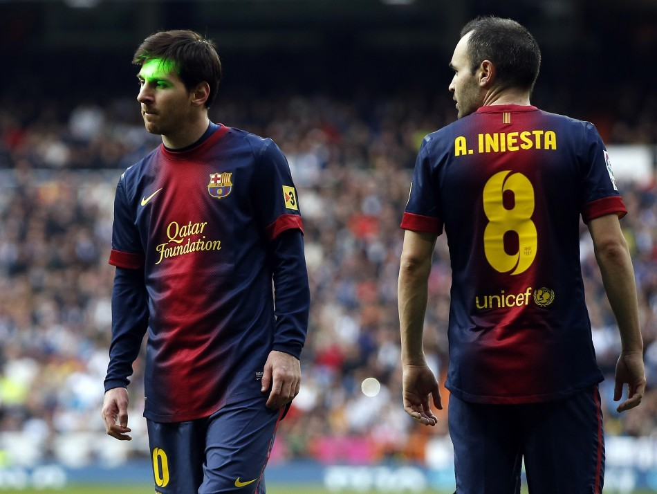 Lionel Messi (L) and Andres Iniesta