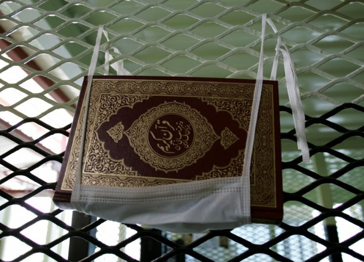 A Koran is shown hanging in a cell in Camp Delta at the Guantanamo Bay