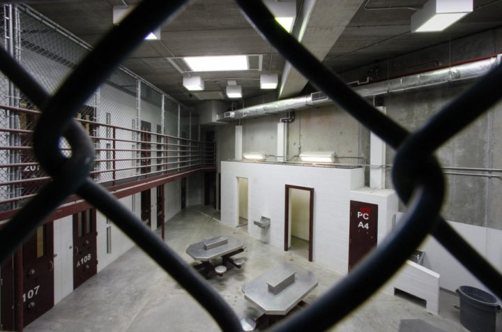 The interior of an unoccupied communal cellblock is seen at Camp VI,