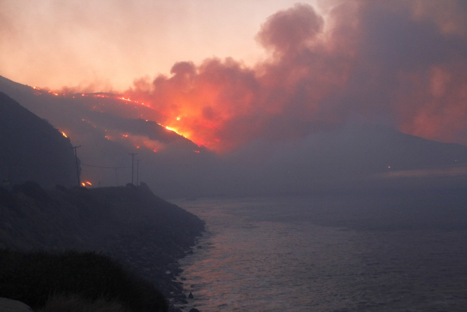 The Springs Fire burns in the early morning near Pacific Coast Highway at Point Mugu State Park, May 3, 2013.