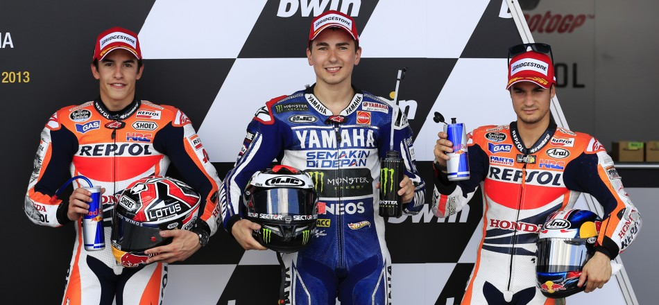 Lorenzo flanked by Marquez (L) and Pedrosa