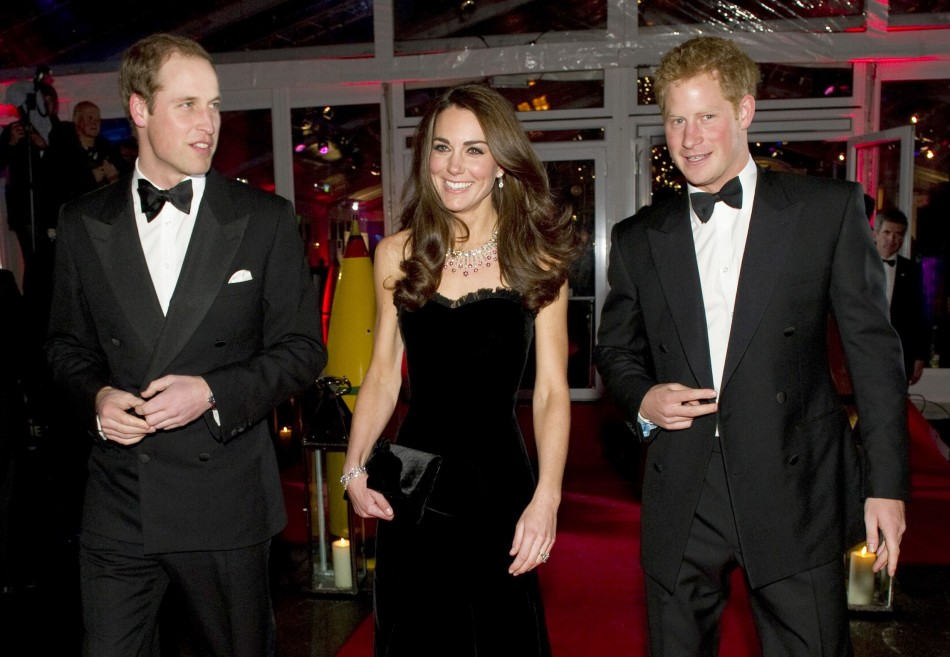 Prince William (L) and his wife Catherine, Duchess of Cambridge and Prince Harry