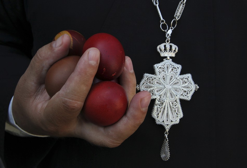 An Orthodox Christian priest holds Easter eggs during an Orthodox Easter mass at Saint Sava church in Mitrovica, May 5, 2013. Ethnic Serbs from the Serb-dominated northern part of the ethnically divided town of Mitrovica cross the bridge to attend a mass