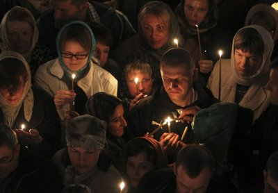 Russian Christian Orthodox worshippers light candles as they wait for a holy Easter service at the Church of St. Peter and Paul in Karlovy Vary May 5, 2013. The spa town of Karlovy Vary has a large number of Russian residents and is also a popular tourist