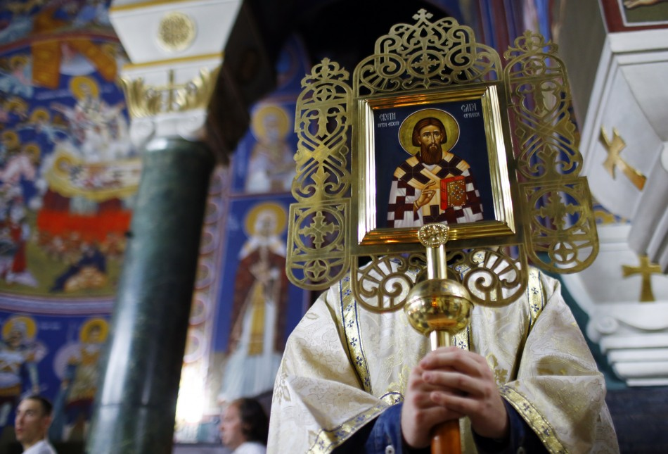 A Serbian priest holds an icon during an Orthodox Easter service in the St. Savas temple in Belgrade May 4, 2013