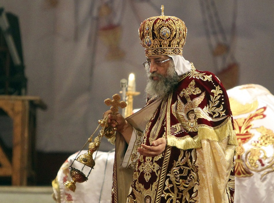 Coptic Pope Tawadros II, head of the Coptic Orthodox church, carries a censer of burning incense as he takes part in a ritual as part of a Coptic Orthodox Easter mass at the main cathedral in Cairo May 4, 2013.