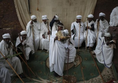 Orthodox Christians pray outside of one of 11 monolithic rock-cut churches, ahead of Orthodox Easter in Lalibela May 4, 2013.