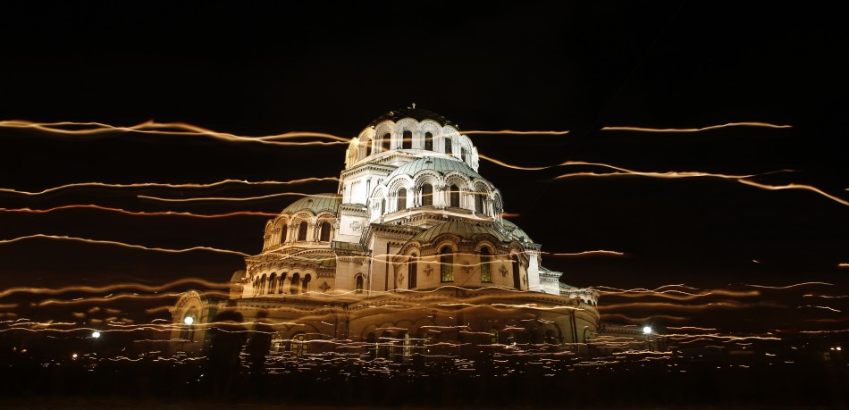 People walk with candles around Alexander Nevski cathedral during an Orthodox Easter service in Sofia May 5, 2013.