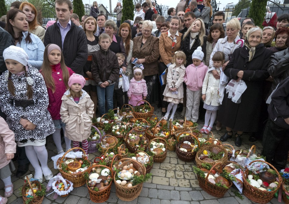 Ukrainian Greek-Catholic believers gather outside a church before an Easter service in Pustomyty village near Lviv May 4, 2013.