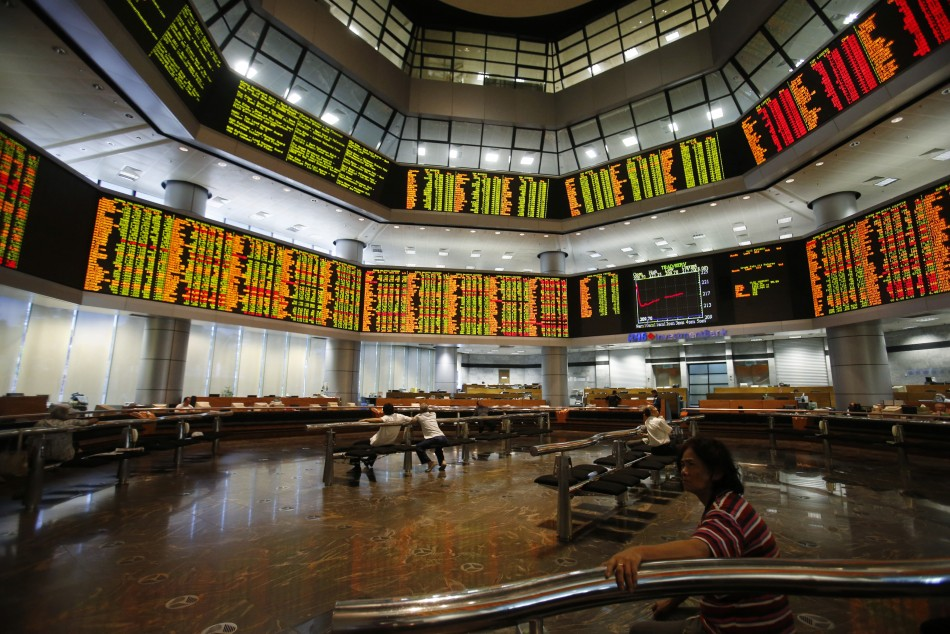 Investors monitor stock market prices in Kuala Lumpur May 6, 2013. Malaysian stocks surged nearly 8 percent to a record high and the local currency jumped to its strongest in 20 months on Monday after the Barisan National (BN) coalition extended its 56-ye