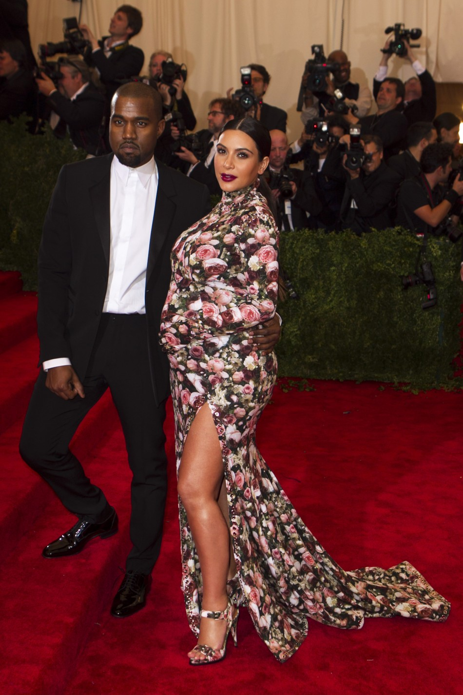Singer Kanye West and reality television actress Kim Kardashian arrive at the Metropolitan Museum of Art Costume Institute Benefit celebrating the opening of PUNK Chaos to Couture in New York