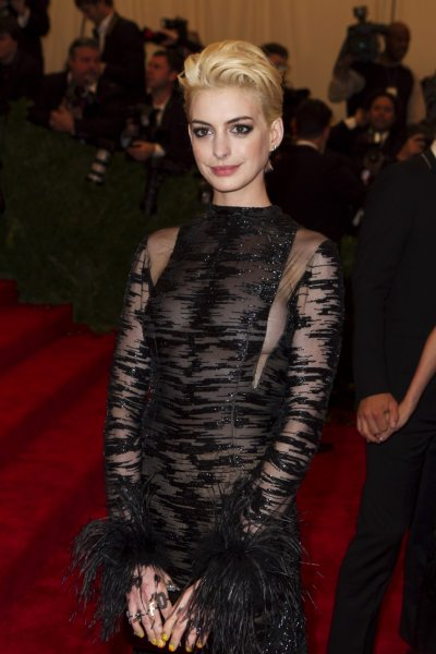 Actress Anne Hathaway arrives at the Metropolitan Museum of Art Costume Institute Benefit celebrating the opening of PUNK Chaos to Couture in New York