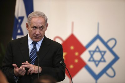 Israels Prime Minister Benjamin Netanyahu gives a speech during a gala dinner in Shanghai