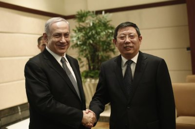 sraels Prime Minister Benjamin Netanyahu shakes hands with Shanghais Mayor Yang Xiong in Shanghai
