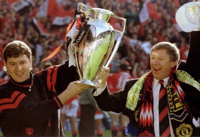 May 8 1994 Ferguson holds the Premier League trophy aloft with the then-assistant manager Brian Kidd at Old Trafford. The Scot led United to two back-to-back league titles, following Premier Leagues inception in 1992.