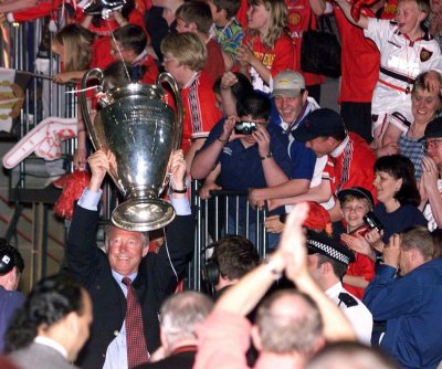 May 27 1999 Ferguson celebrates his first European glory at the MEN Arena in Manchester at the end of their parade of the city. United had won the treble that season the FA cup, Premier league, and the European Cup.