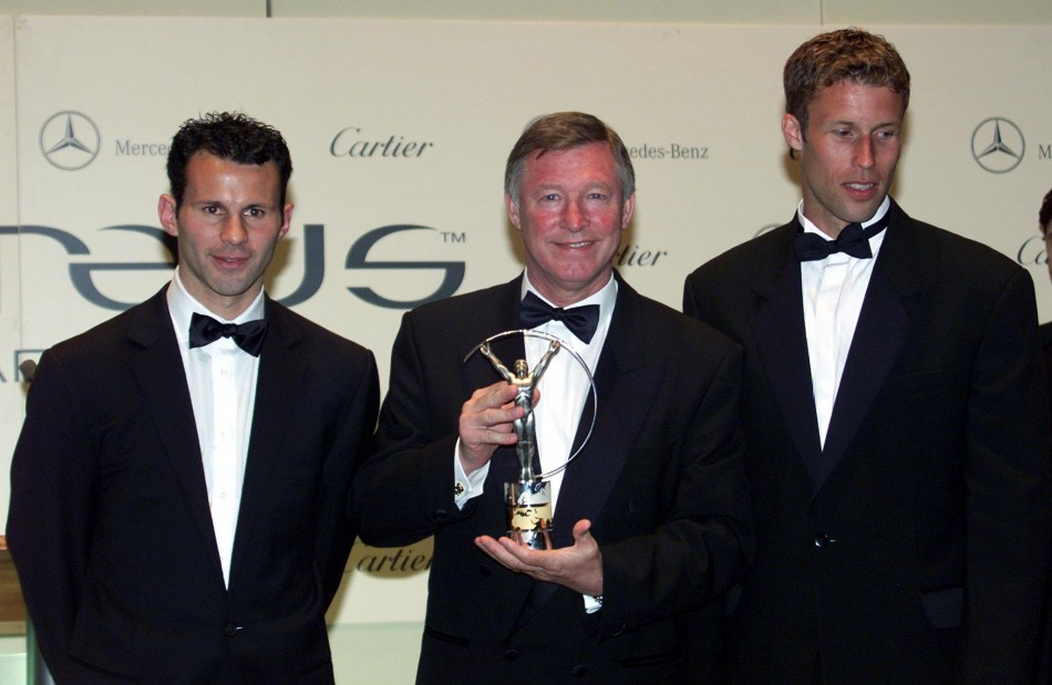 May 25 2000 Ferguson shows his World Team of the Year Laureus sports award in Monte Carlo. The Scot is flanked by United players Giggs L and Ronnie Johnsen. The Laureus sports awards were the first annual ceremony to acknowledge sporting excellence acr