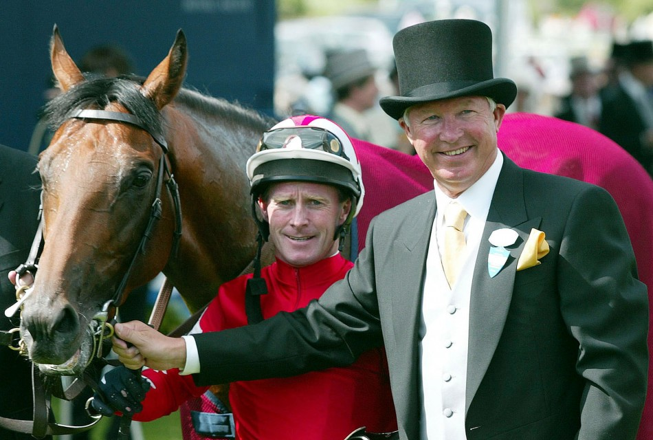 June 18 2002 Ferguson with his horse Rock of Gibraltar and jockey Mick Kinane after winning the St Jamess Palace Stakes on the first day of Royal Ascot in Berkshire.