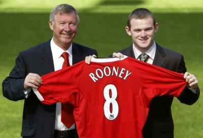 September 1 2004 New United signing Wayne Rooney holds up his club shirt with Ferguson at Old Trafford. A teenage Rooney, who arrived in a 25.6m deal, said United were the only team he wanted to join once he knew the club were interested in him.