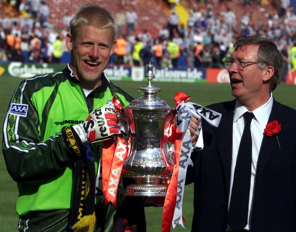 Peter Schmeichel holds the FA Cup with manager Alex Ferguson after defeating Newcastle United 2-0 in 1999 (Reuters)